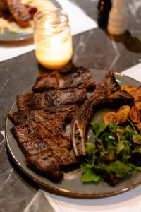 Beef steak with baked patatoes and green salad